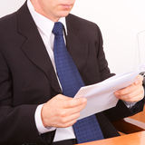 Businessman reading a letter. Stock Image