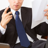 Businessman reading a letter and calls Stock Photos
