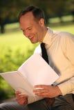Businessman reading magazine Royalty Free Stock Images