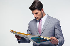 Businessman reading magazine Stock Images