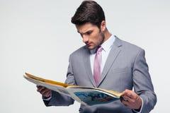 Businessman reading magazine Stock Images