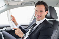 Businessman reading a map Stock Photos