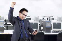Businessman reading a message in office room Stock Images
