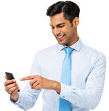 Businessman Reading Message On Smart Phone Stock Photo