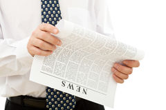 Businessman reading news Stock Images
