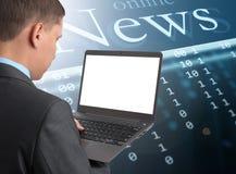 Businessman reading news. At laptop computer Royalty Free Stock Image