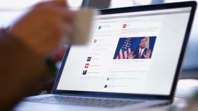 Businessman reading news cnn on a laptop stock footage