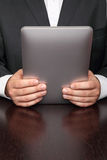 Businessman reading on  tablet Stock Images