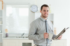 Businessman reading the news while having breakfast Royalty Free Stock Photo