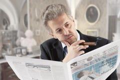 Businessman reading a newspape Stock Photo