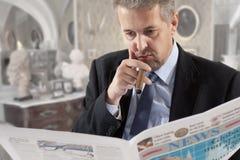 Businessman reading a newspape Royalty Free Stock Photo
