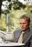 Businessman reading newspaper Royalty Free Stock Photo