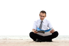 A businessman reading newspaper Royalty Free Stock Photography