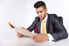 Businessman reading the newspaper Royalty Free Stock Photos