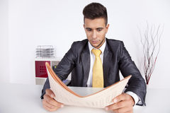 Businessman reading the newspaper Stock Image