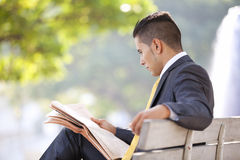 Businessman reading the newspaper Royalty Free Stock Images