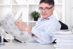 Businessman reading newspaper Royalty Free Stock Photo