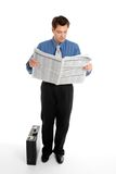 Businessman reading newspaper Stock Images