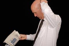 Businessman reading newspaper Stock Image
