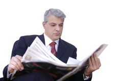 Businessman reading newspaper. Young businessman reading his newspaper Royalty Free Stock Photography