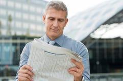 Businessman Reading Newspaper Royalty Free Stock Image