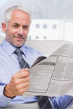 Businessman reading a newspaper Stock Images