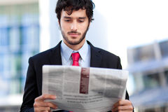 Businessman reading the newspaper Stock Photography