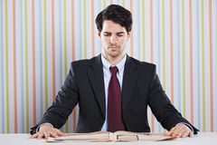 Businessman reading the newspaper Royalty Free Stock Image