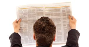 Businessman reading a newspaper isolated Stock Photography