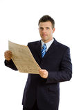 Businessman reading newspaper isolated Royalty Free Stock Photos