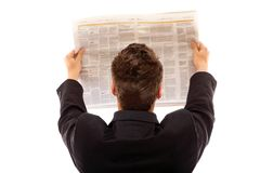 Businessman reading a newspaper isolated Stock Image