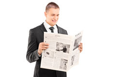 Businessman reading a newspaper Stock Photo
