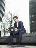 Businessman Reading Newspaper Outdoors Stock Photography