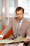 Businessman reading newspaper, portrait Royalty Free Stock Images