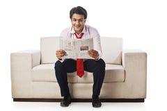 Businessman reading newspaper Royalty Free Stock Photos