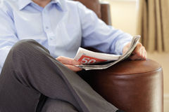 Reading a newspaper Stock Photography