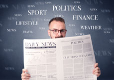 Businessman reading newspaper. Young smart businessman reading daily newspaper Royalty Free Stock Image