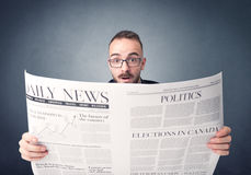 Businessman reading newspaper. Young smart businessman reading daily newspaper Stock Photos