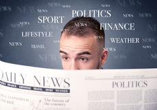 Businessman reading newspaper. Young smart businessman reading daily newspaper Stock Images