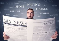 Businessman reading newspaper. Young smart businessman reading daily newspaper Stock Image
