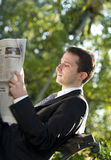 Businessman reading newspapers Royalty Free Stock Images