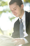 Businessman reading newspapers Stock Photos