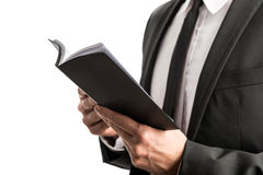Businessman reading from a notebook Royalty Free Stock Photography