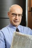 Businessman reading paper Stock Photo