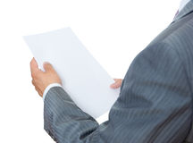 Businessman reading papers Stock Photography