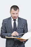 Businessman reading Royalty Free Stock Images