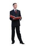 Businessman reading red book Stock Image