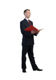 Businessman reading red book Royalty Free Stock Photography
