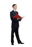 Businessman reading red book Royalty Free Stock Photo