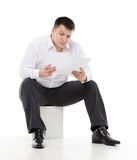 Businessman reading a report with scepticism Royalty Free Stock Photos